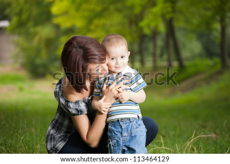 happy little boy in the park with mother