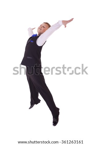 Happy little boy jumping in the studio, isolated on white background - stock photo