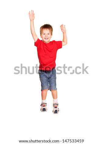 Happy little boy jumping. Isolated on white background. - stock photo