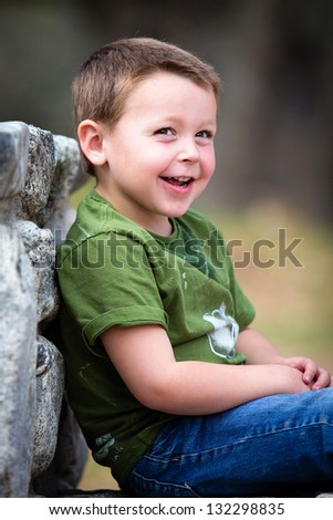 Happy little boy outdoors - stock photo