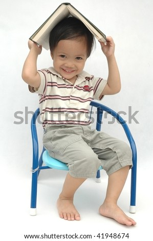 Happy little boy with a book - stock photo