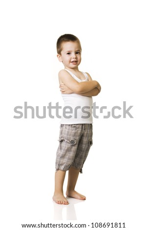 happy little boy with arms crossed  over white background - stock photo