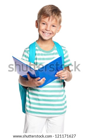 Happy little boy with book isolated on white background