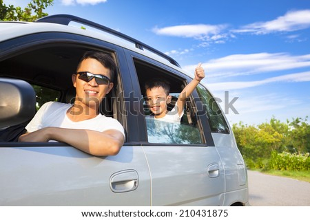 happy little boy with father sitting in the car - stock photo