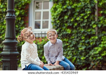 Happy little brother and sister having fun  - stock photo