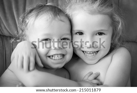 happy little brother and sister hugging ( black and white ) - stock photo