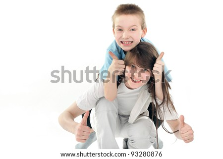happy little brother and sister on the white background - stock photo