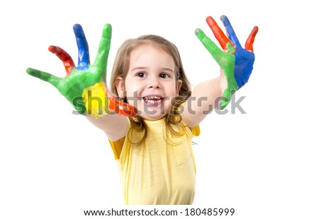 happy little caucasian girl 3-4 years old with hands painted in vivid colors isolated on white background - stock photo