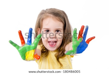 happy little caucasian girl 3-4 years old with hands painted in vivid colours isolated on white background - stock photo