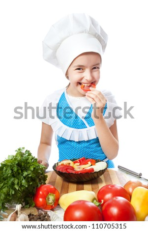 Happy little chef cook tastes salad with Bell Pepper on a white background
