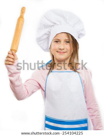 Happy little chef holding a rolling pin - stock photo
