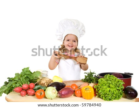 Happy little chef with lots of vegetables - healthy diet concept, isolated - stock photo
