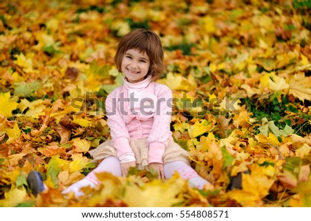 happy little child, laughing and playing in the autumn on the nature walk outdoors