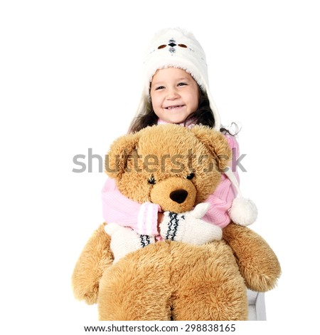 happy little child with a toy bear
