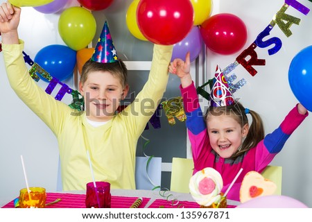 Happy little children are having fun in a birthday party