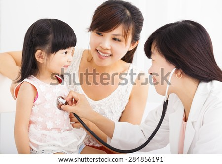 happy Little girl and young  in hospital having examination - stock photo