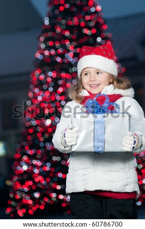 Happy little girl at Christmas time - stock photo