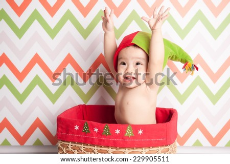 happy little girl at the christmas time. Beautiful expressive adorable happy cute laughing smiling baby infant face hands up, isolated. - stock photo
