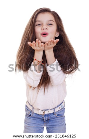 Happy little Girl Blowing a Kiss, isolated on white background - stock photo