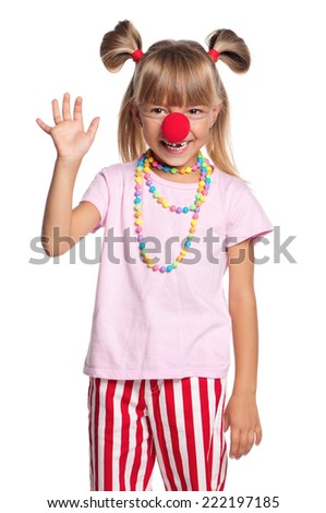 Happy little girl. Cheerful little girl with clown nose, isolated on white background.