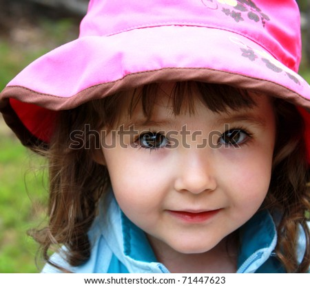 Happy little girl close-up - stock photo