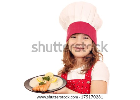 happy little girl cook hold dish with salmon seafood