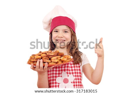 happy little girl cook hold with bruschetta and thumb up - stock photo
