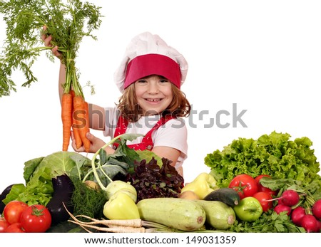 happy little girl cook holding carrot