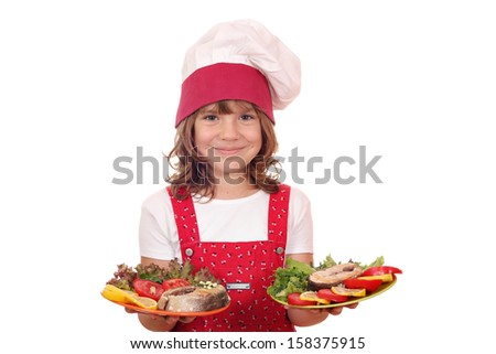 happy little girl cook holding plate with salmon seafood - stock photo