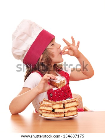happy little girl cook with apple cakes - stock photo