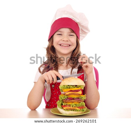 happy little girl cook with big hamburger ready for lunch - stock photo
