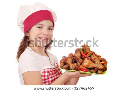 happy little girl cook with chicken drumstick - stock photo