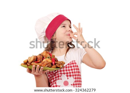 happy little girl cook with chicken drumstick and ok hand sign - stock photo