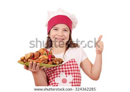 happy little girl cook with chicken drumstick and thumb up - stock photo