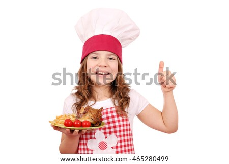 happy little girl cook with chicken wings and thumb up