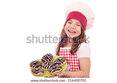 happy little girl cook with chocolate donuts - stock photo