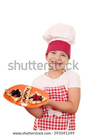 happy little girl cook with crepes - stock photo