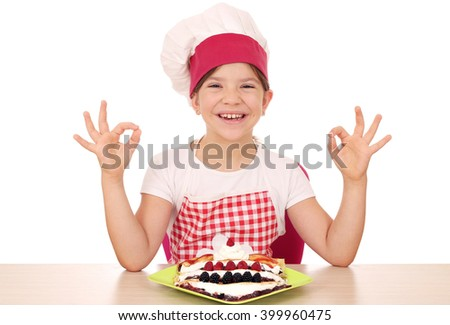 happy little girl cook with crepes and ok hand signs - stock photo