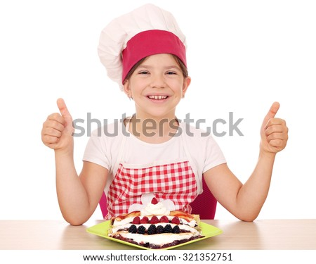 happy little girl cook with crepes and thumbs up - stock photo