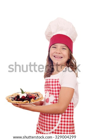 happy little girl cook with delicious sweet crepes - stock photo