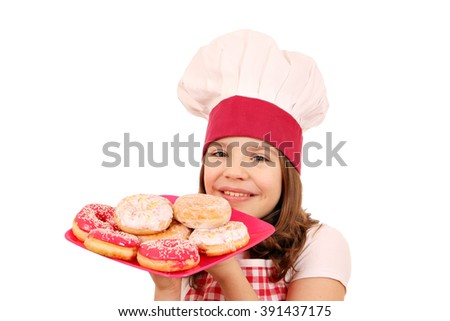 happy little girl cook with donuts on plate - stock photo