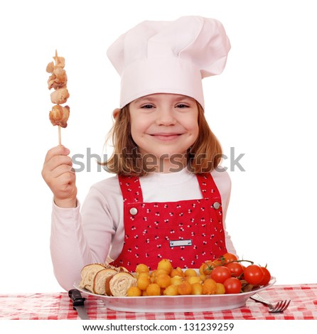 happy little girl cook with grilled chicken meat - stock photo