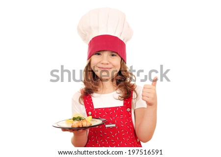 happy little girl cook with salmon and thumb up - stock photo