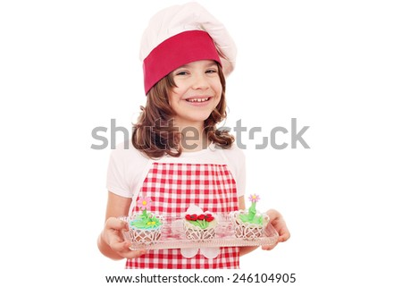 happy little girl cook with spring flower cupcakes - stock photo