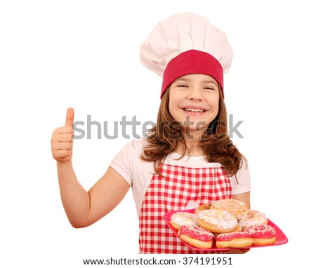 happy little girl cook with sweet donuts and thumb up - stock photo