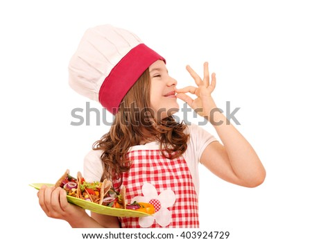 happy little girl cook with tacos and ok hand sign - stock photo