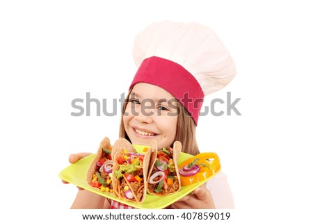 happy little girl cook with tacos fast food - stock photo