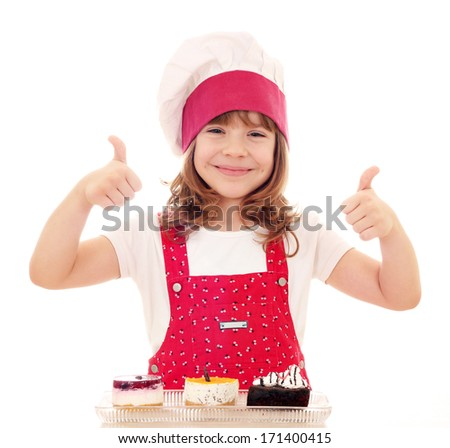 happy little girl cook with thumbs up and cakes - stock photo
