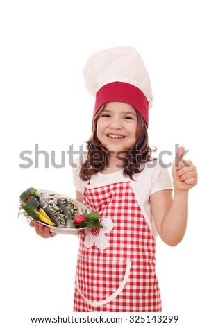 happy little girl cook with trout fish and thumb up - stock photo