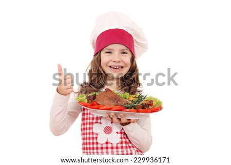 happy little girl cook with turkey drumstick and thumb up - stock photo